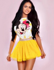 Escort Bonita in her playful yellow skirt and Disney top
