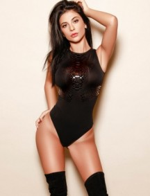 Model Rowen in her black bodysuit and stockings