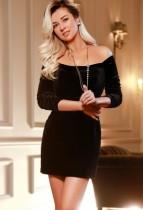 Charlotte in a sexy little black dress tt