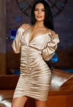 Beautiful brunette escort Ruth in a sexy gold dress tt