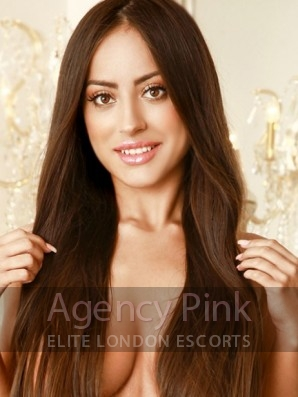 Escort Fifi with long brunette hair in her pink lknickers Picture 1