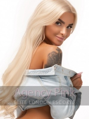 Blonde escort Celia in her shirt and thong Picture 1