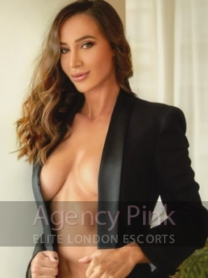 Escort Meghan in her knickers and smart jacket Picture 1