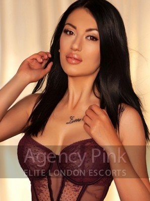 Brunette escort Drew in her sexy designer lingerie Picture 1