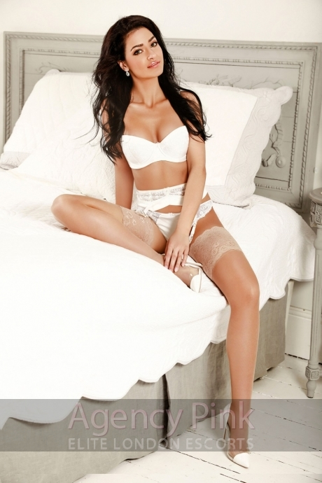 Escort Adelyn in her white lingerie on the bed Picture 4