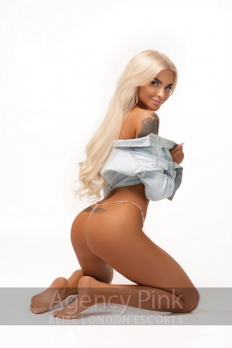 Blonde escort Celia in her shirt and thong Picture 4