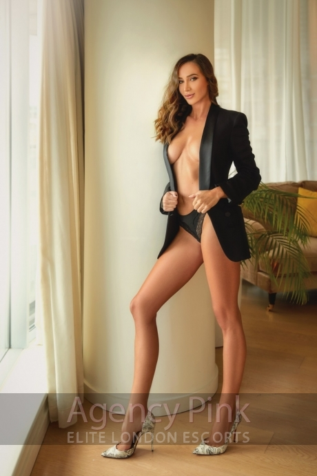 Escort Meghan in her knickers and smart jacket Picture 4