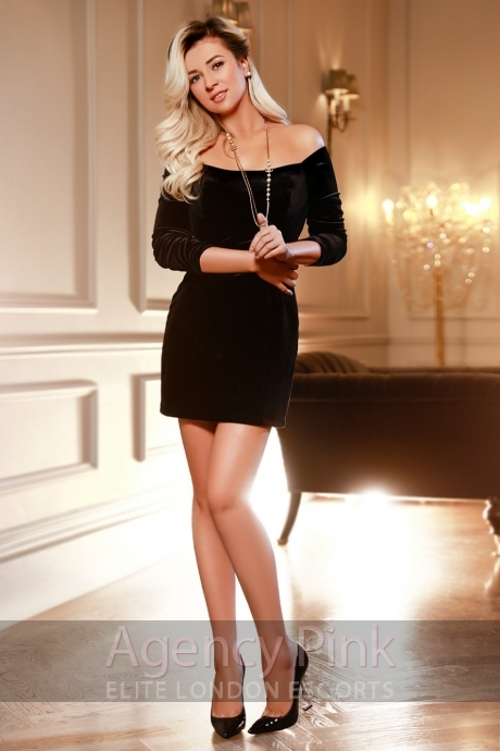 Charlotte in a sexy little black dress and heels Picture 5